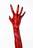 Czerwonego diabła ręki z czerń gwoździami, czerwone ręki szatan, Halloweenowy temat na białym tle, odizolowywającym Obrazy Stock
