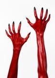 Czerwonego diabła ręki z czerń gwoździami, czerwone ręki szatan, Halloweenowy temat na białym tle, odizolowywającym Obraz Royalty Free
