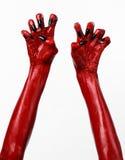 Czerwonego diabła ręki z czerń gwoździami, czerwone ręki szatan, Halloweenowy temat na białym tle, odizolowywającym Zdjęcia Royalty Free