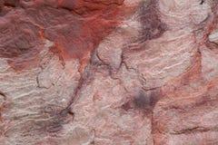 Czerwonego koloru piaska kamienia tło, piasek kamienna ściana Zdjęcia Royalty Free