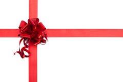 Czerwonego prezenta tasiemkowy łęk błyszcząca tkanina Fotografia Royalty Free