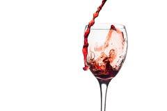Czerwonego Wina pluśnięcie w szkle Zdjęcia Stock