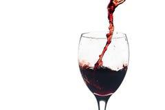 Czerwonego Wina pluśnięcie w szkle Fotografia Royalty Free
