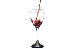 Czerwonego Wina pluśnięcie w szkle Obrazy Royalty Free