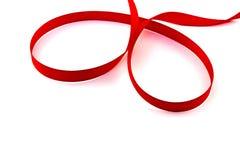 Czerwonej taśmy pętla na białym tle Zdjęcia Royalty Free