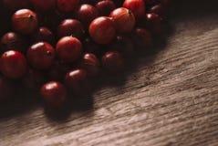 Czerwoni agresty na drewnianym tle Obrazy Royalty Free