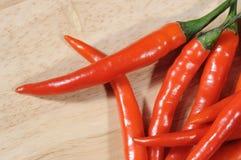 Czerwoni chillies na masarce Zdjęcie Royalty Free