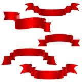 Czerwoni dekoracyjni faborki ustawiający Zdjęcia Royalty Free