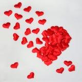 Czerwoni dekoracyjni serca w formie dużego serca Zdjęcia Stock