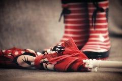 Czerwoni gumowi buty i parasol Obraz Stock