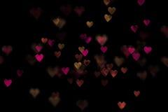 Czerwoni i żółci bokeh serca Obraz Royalty Free