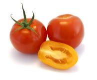 Czerwoni i żółci pomidory na białym tle Zdjęcia Stock