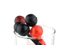Czerwoni i czarni lizaki w szkle Zdjęcie Stock