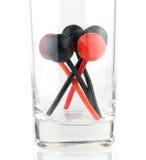 Czerwoni i czarni lizaki w szkle Fotografia Stock