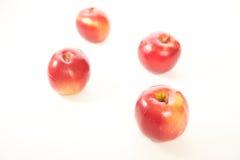 Czerwoni jabłka odizolowywają Zdjęcia Stock