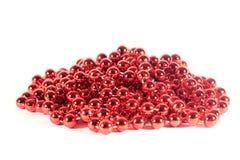 Czerwoni koraliki odizolowywający dla nowego roku Obraz Stock