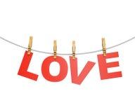 Czerwoni listy miłośni wiesza na arkanie z clothespins, odizolowywającymi na bielu Fotografia Stock