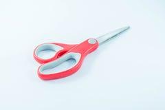 Czerwoni nożyce na białym tle Zdjęcia Royalty Free