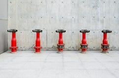 Czerwoni pożarniczy hydranty Zdjęcia Stock