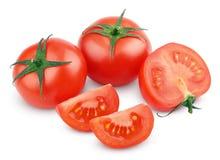 Czerwoni pomidorowi warzywa z cięciem na bielu obrazy stock