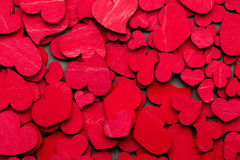 Czerwoni serca na drewnianym tle Fotografia Stock