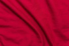 Czerwony Łóżkowych prześcieradeł tło, tekstura Zdjęcie Stock