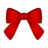 Czerwony świąteczny wiązany łęk robić od faborku Fotografia Stock