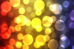 czerwony żółty błękitny mieszanki kolor Rozjarzonego Lekkiego Bokeh Szczotkarski i Tapetowy tło Zdjęcia Royalty Free