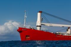 Czerwony ładunku statek w morzu Obraz Royalty Free