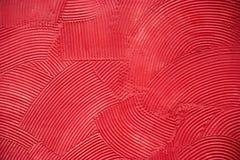 Czerwony artystyczny handcraft kurenda wzór na cement ścianie zdjęcie stock