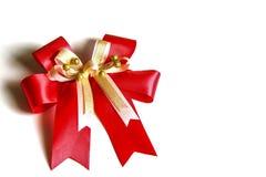 Czerwony atłasowy prezenta łęk. Faborek Fotografia Royalty Free