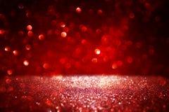 Czerwony błyskotliwość rocznik zaświeca tło defocused fotografia stock