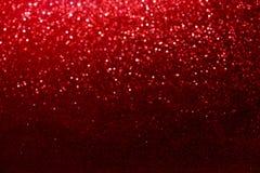 Czerwony błyskotliwości bokeh zaświeca Zamazanego abstrakcjonistycznego tło dla walentynek, urodziny, rocznica Obrazy Stock