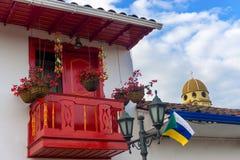 Czerwony balkon i kościół kopuła Zdjęcia Stock