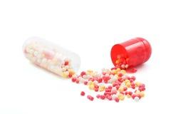 czerwony białe pigułki kapsułki Fotografia Stock