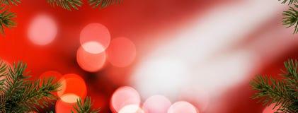 Czerwony Bożenarodzeniowy tło z igłami Zdjęcie Stock