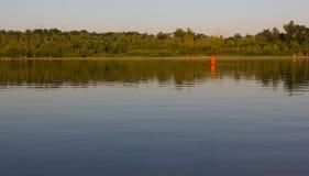 Czerwony boja na wodnym gładzi Zdjęcia Stock