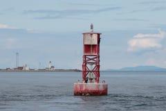 Czerwony boja z punktu Wilson latarni morskiej tłem Zdjęcia Royalty Free
