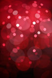 Czerwony bokeh zaświeca tło Fotografia Stock
