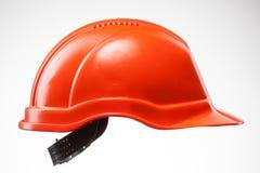 Czerwony ciężki kapelusz na bielu Obrazy Stock