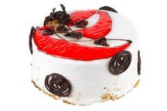 Czerwony creme dekorujący tort odizolowywający na bielu Obrazy Royalty Free