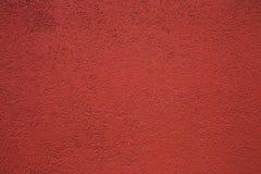 Czerwony dekoracyjny tynk fotografia stock