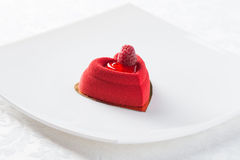 Czerwony deser z malinką Obrazy Stock
