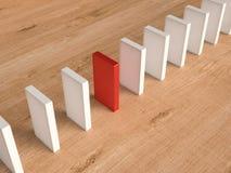 Czerwony domino dla przywódctwo pojęcia Zdjęcia Stock