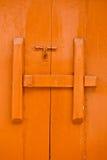Czerwony drewniany drzwi zdjęcia stock