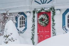 Czerwony drzwi w Śnieżnej burzy Obraz Royalty Free