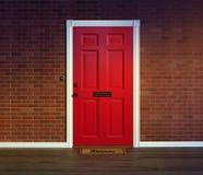 Czerwony dzwi wejściowy z mile widziany matą Fotografia Stock