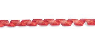 Czerwony faborek przekręcająca spirala obrazy stock