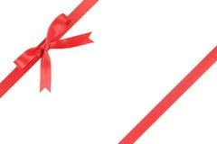 Czerwony faborek z łękiem dla pakować z ogonami zdjęcie royalty free