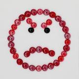 Czerwony gniewny smilie od smalt zdjęcia stock